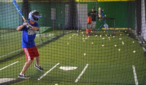 Boy practicing batting in a Nashville area batting cage