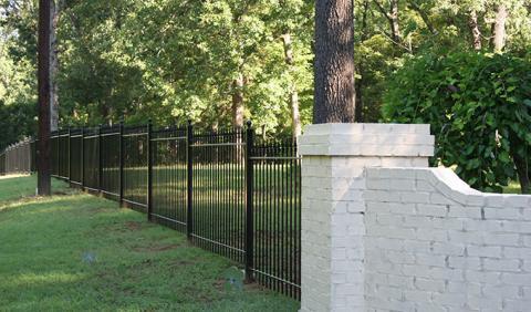 Sloped Nashville yard with iron fencing