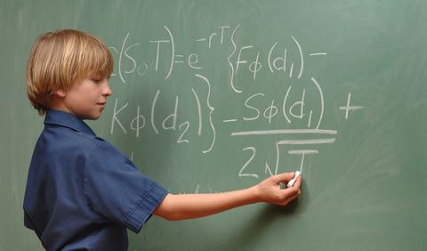 Young man completing a problem on the board of a Nashville private school