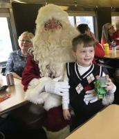 Every family gets a visit from Santa and Mrs Claus - get time to get a picture