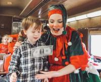 This elf is learning a parlor game with Conner as he enjoys the North Pole Express