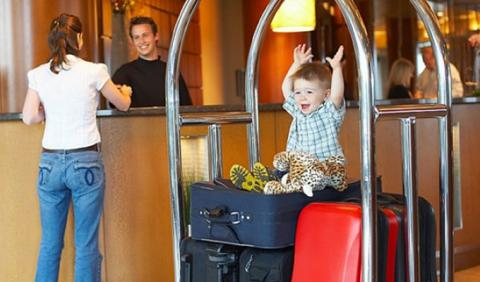 Kids and Luggage checking into Nashville Hotel